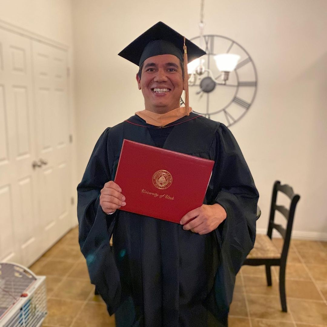 Michael Langell graduates for the UofU with his MBA